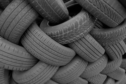 Old used tires from cars and trucks on a pile. Ready for rubber recycling or disposal.