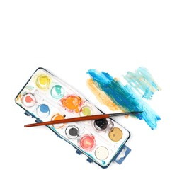 old used watercolor box and brush painting isolated on white