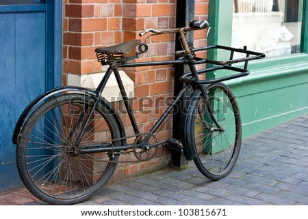 Old Victorian Bicycle Standing Outside A Victorian Shop Window.