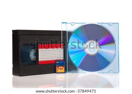 Old Video Cassette tape, with a DVD disc and Flash Memory Card isolated on white background