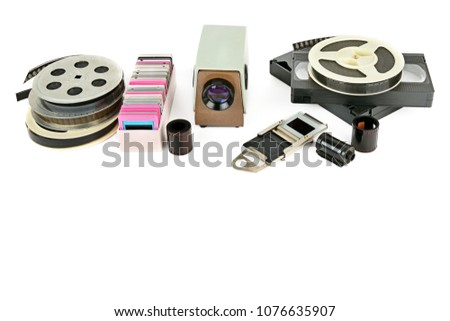 Old videocassettes and video projector with slides isolated on white background. Free space for text. #1076635907