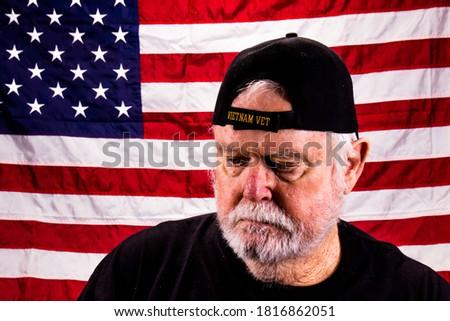 Old Vietnam Vet With Scraggly Beard Looking Down Stock foto ©