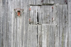 Old village basketball hoop. Hung on the wall of the barn. Photographed in Lithuania