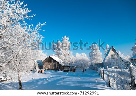Old village house in cold winter day
