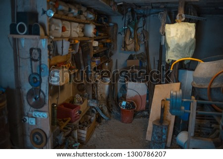 Old village workshop room with miscellaneous tools #1300786207