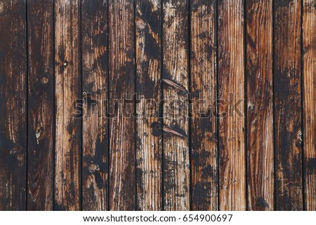 Old vintage aged grunge brown and gray wooden floor planks texture background with dark black stains and contrast light scratches #654900697