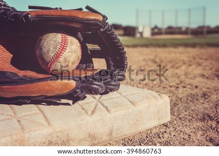 Old Vintage Baseball and glove resting on a base