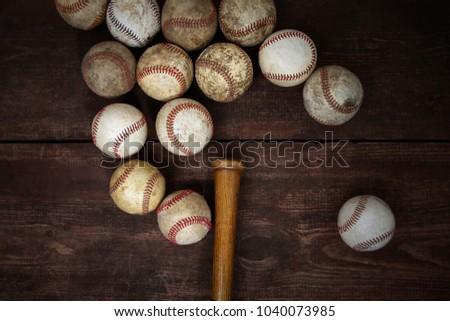 Old Vintage Baseballs on a wooden background