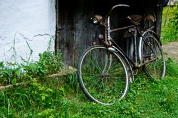 Old vintage bicycle near the house in the village