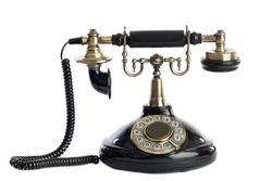 Old vintage black phone a over white background.