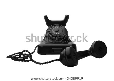 old vintage black rotary telephone isolated on white