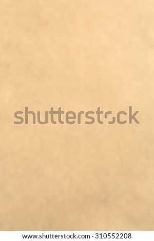 Old vintage blurry brown cardboard paper texture for blurry background