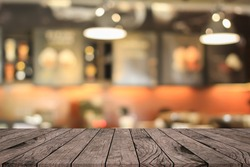 old vintage brown wood tabletop with blurred restaurant bar cafe light color background: for show or promote and advertise product on display