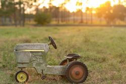 Old Vintage Children's Tractor at Sunset on the Farm