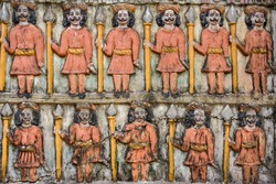 Old vintage colorful carving at the hindu temple in India. Detail of the indian temple wall close up background