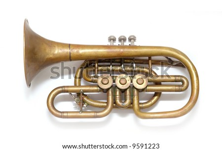 Old vintage copper trumpet isolated over white