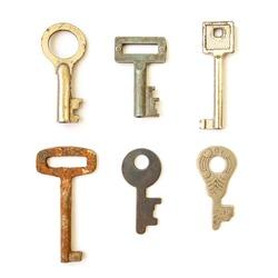Old vintage keys isolated on white background