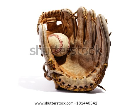 Old vintage leather baseball glove with the baseball held in the palm by the thumb standing upright on a white background #181440542