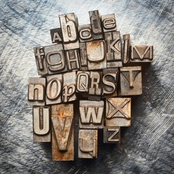 Old vintage letterpress type letters alphabet grunge background