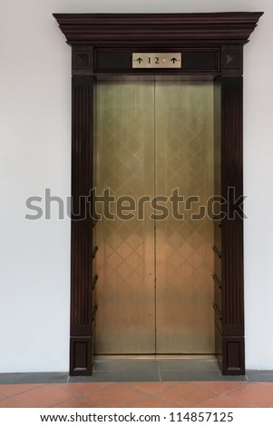Old vintage lift with three levels on white wall