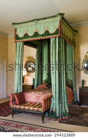 Old vintage mahogany four poster large double bed