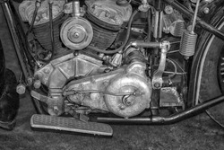 Old vintage motorcycle engine 20th century The old motor the motor of the motorcycle (black and white photo)