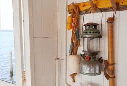 Old Vintage oil lamp hanging on the wall of fisherman beach house
