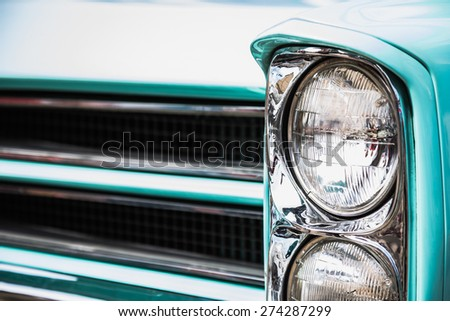 Old vintage or retro car auto front lights or headlights