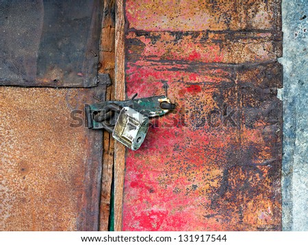 Old vintage padlock on the door of the barn