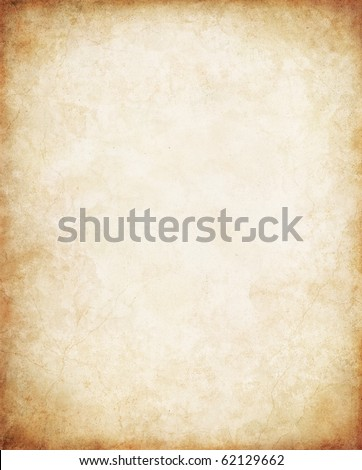 Old vintage paper with a glowing center and grunge vignette. Stock photo ©