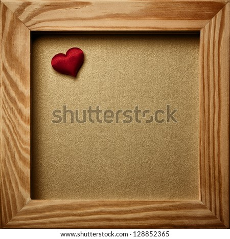 Old vintage photo frame and red heart.
