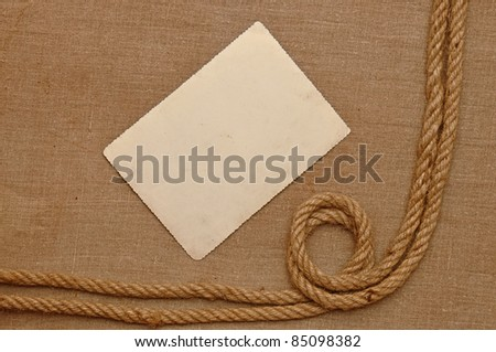 Old vintage photo with a rope on brown canvas background