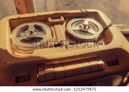 Old vintage player of reels. The antique Reel-to-Reel. Tape Recorder with spools #1212479875