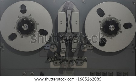 Old vintage player of reels. The antique Reel-to-Reel. Tape Recorder with spools. Bobbin tape recorder.