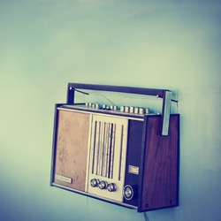 Old vintage radio over wall/old dirty tuner in vintage color,selective focus