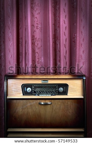 Old vintage radio with city names on red background! Ideal for concept photo