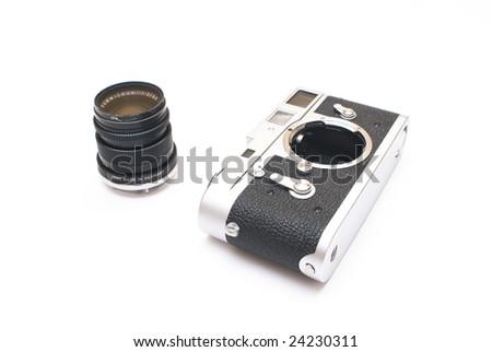 Old vintage rangefinder photo camera isolated over white background