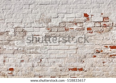 Old Vintage Red Brick Wall With Crashed White Plaster Texture Background. White  Red Retro  Wallpaper. Grungy Street Exterior Wall Surface. Abstract Urban Rough Pattern. Graffiti Brickwal Closeup #518833657