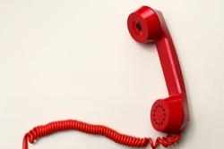 Old vintage red handset, background