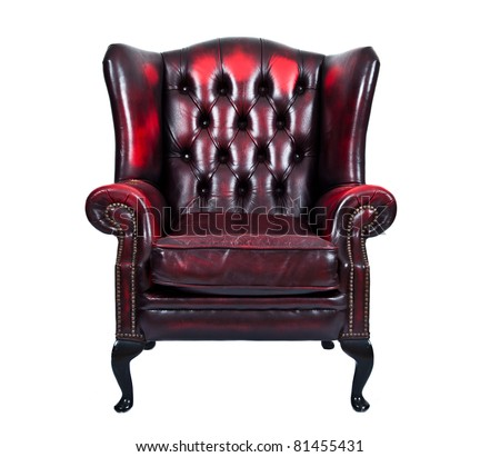 Vintage chairs on old vintage red leather chair isolated on white