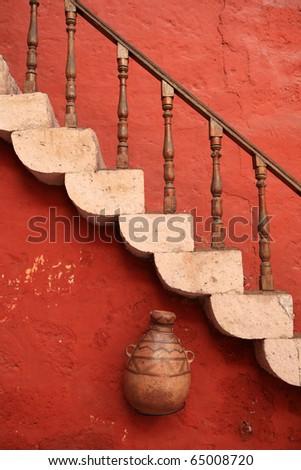 Old, vintage red stone steps. Cuzco, Peru. - stock photo
