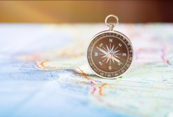 Old vintage retro compass and ancient map. Travel geography navigation concept