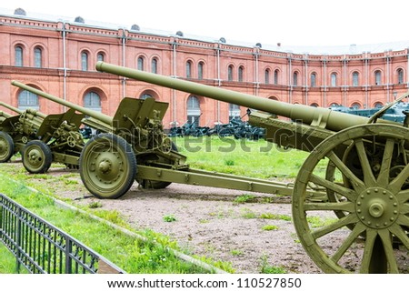 Old vintage Russian artillery systems and equipment on green grass taken on a sunny day, can be use for various military purposes
