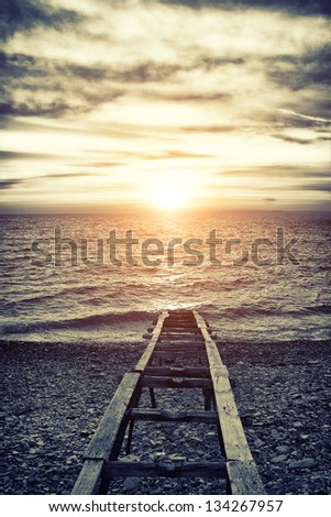 Old vintage sea wharf during sunset