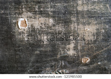 Old Vintage Shabby Fabric with Holes Background