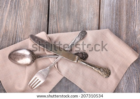 Old vintage silverware on wooden table