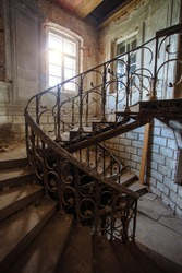 Old vintage spiral staircase at the old abandoned building