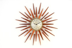 Old vintage star or sun burst shaped wooden wall clock