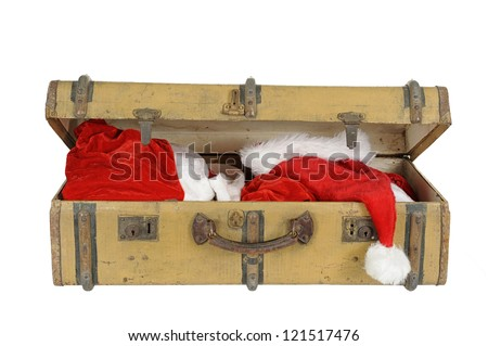 old vintage suitcase with santa clothes, isolated on white