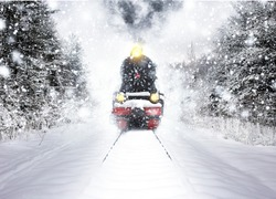 Old vintage train in the snow. Winter snow forest train ride in winter snow forest. Fairy tale winter landscape